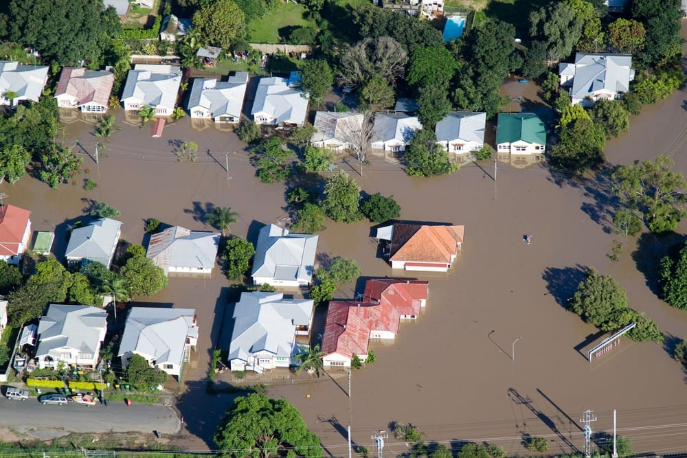 Aerial view of homes under water in flood